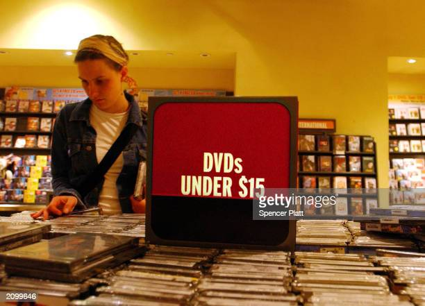 A woman shops for DVDs June 20 2003 in New York City For the first time last week weekly rentals of DVDs surpassed VHS videos According to the trade...
