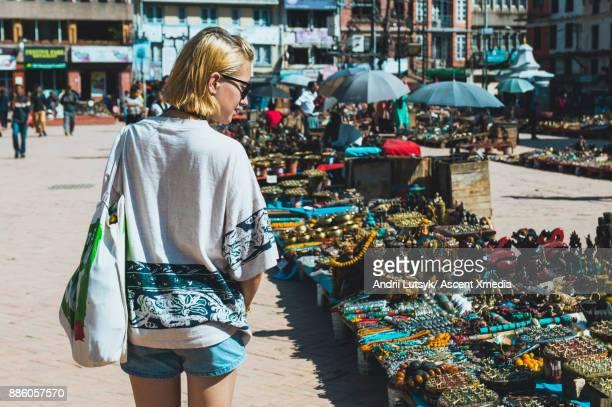 Woman shops for handicrafts at street market
