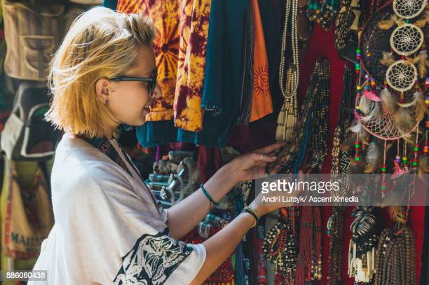 Woman shops for handicrafts at street market