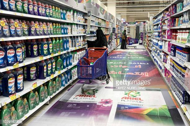 Woman shops for laundry detergent at a supermarket in Saudi Arabia's capital Riyadh on October 18, 2020. - Following a call by the head of the Saudi...