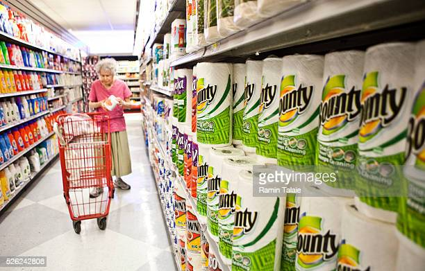 A woman shops for paper products at a supermarket in New York City on Tuesday August 3 2010
