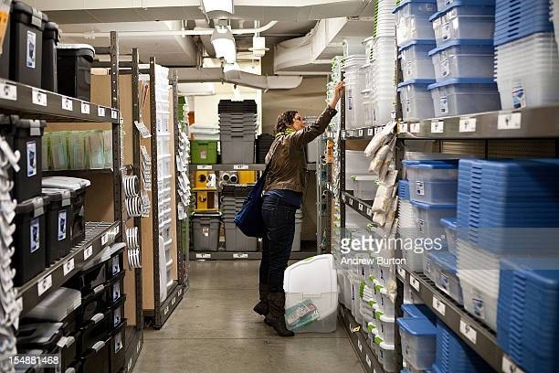 A woman shops for plastic containers at Home Depot prior to the arrival of Hurricane Sandy on October 28 2012 in New York United States Sandy which...