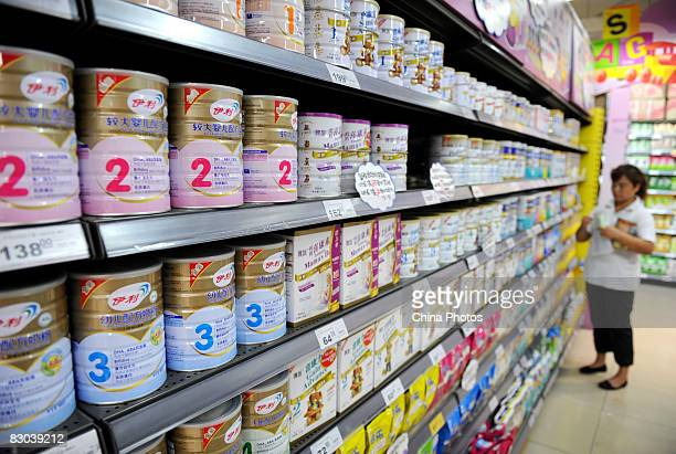 A woman shops for powdered milk at a supermarket on September 28 2008 in Chengdu of Sichuan Province China Approximately 53000 infants were...