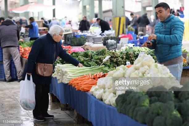 A woman shops for vegetables at a market in the Turkish capital Ankara on February 13 2019 Confronted with persistently high inflation more than a...