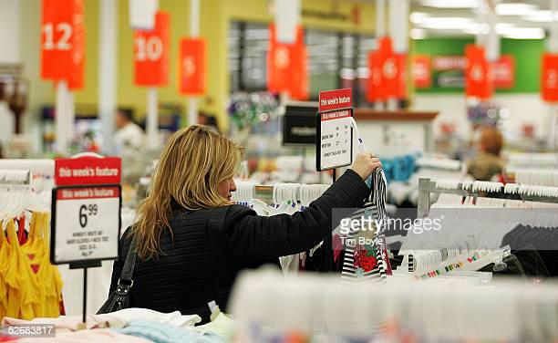 A woman shops for women's clothing in a newly revamped Kmart store April 22 2005 in Norridge Illinois The store is one of nine test stores where some...