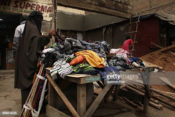 """Woman shops in a market in Eastleigh, a predominantly Muslim Somali neighborhood on August 18, 2009 in Nairobi, Kenya. Referred to locally as """"Little..."""