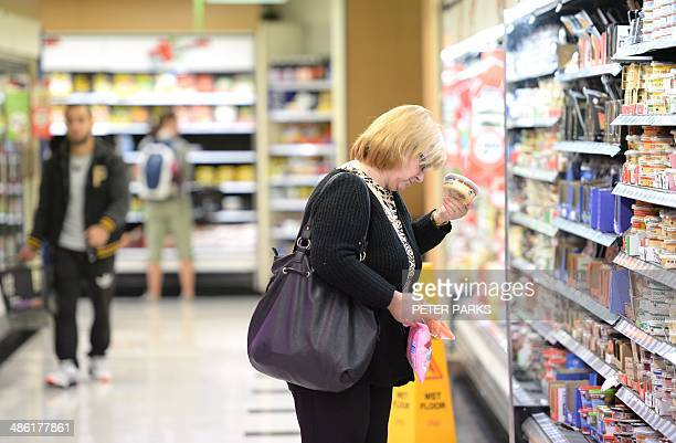 A woman shops in a supermarket in Sydney on April 23 2014 Australian inflation eased in the first quarter of the year official data showed on April...