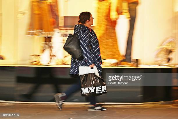 A woman shops in the Myer Melbourne department store on Bourke Street on July 30 2015 in Melbourne Australia Myer is dropping 100 national and...