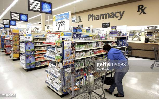 A woman shops in the pharmacy area of a WalMart store September 21 2006 in Mount Prospect Illinois WalMart announced today they plan on reducing...