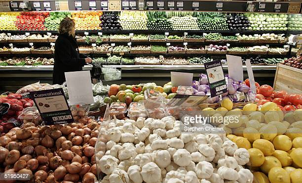 A woman shops in the produce section at Whole Foods January 13 2005 in New York City New eating guidelines issued by the US government stress the...