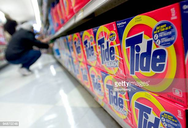 A woman shops near a display of Tide laundry detergent in an Associated Supermarket on October 27 2004 Procter Gamble Co the biggest US...