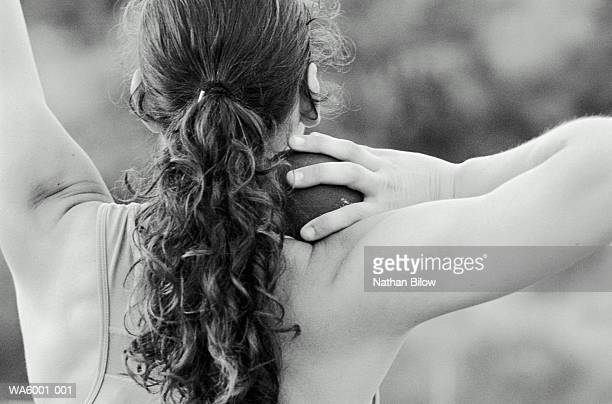 woman shot-putter holding shot, close-up (b&w) - shot put stock pictures, royalty-free photos & images
