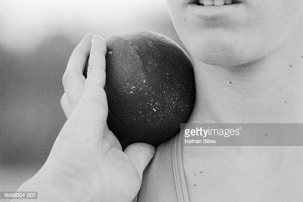 woman shot-putter holding shot on shoulder, close-up (b&w) - shot put stock pictures, royalty-free photos & images