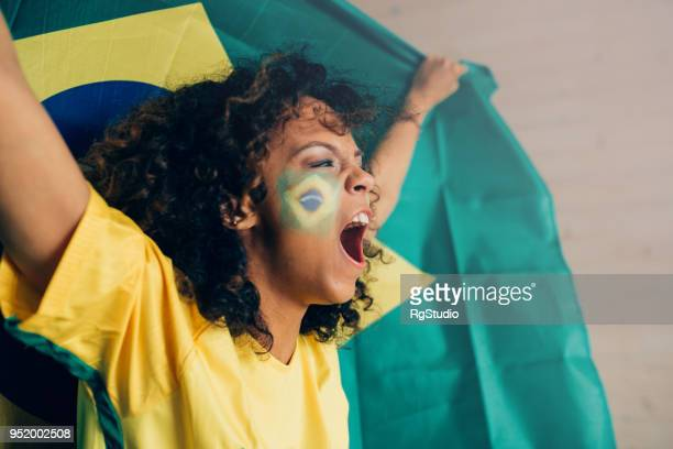 Woman shouting and watching Brazilian league football