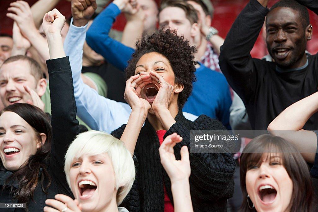 Woman shouting at football match : Stock Photo