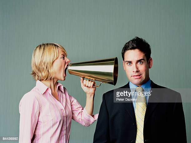 woman shouting at men with phone - wife stock pictures, royalty-free photos & images