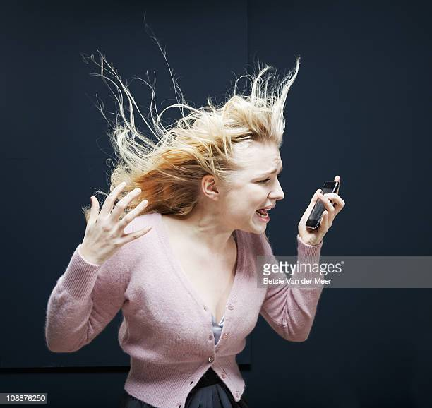 Woman shouting in phone.