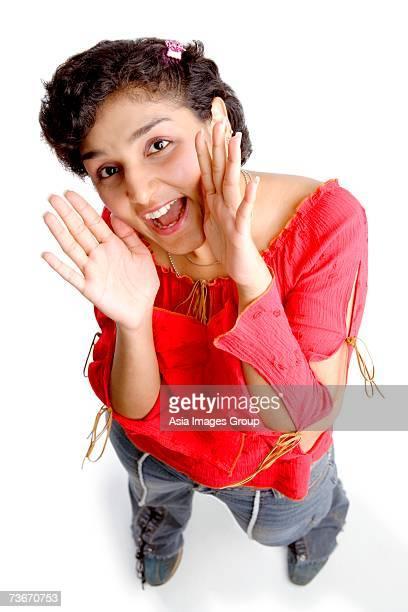 Woman shouting, looking up at camera