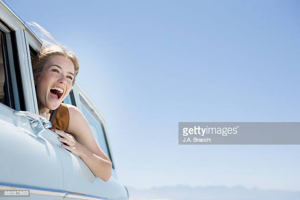 Woman shouting out car window