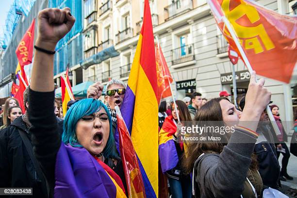 A woman shouting slogans against monarchy during a demonstration demanding a Republic on the anniversary of the Spanish Constitution