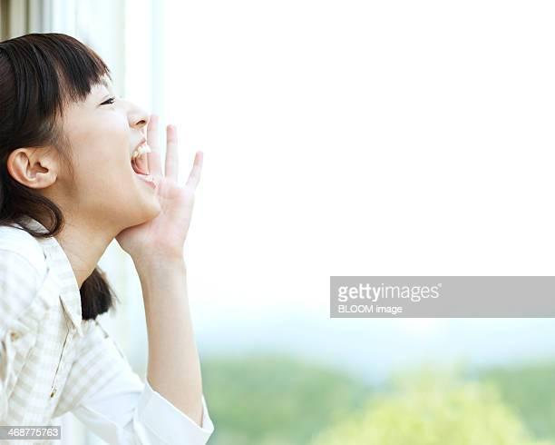 Woman Shouting Through Window