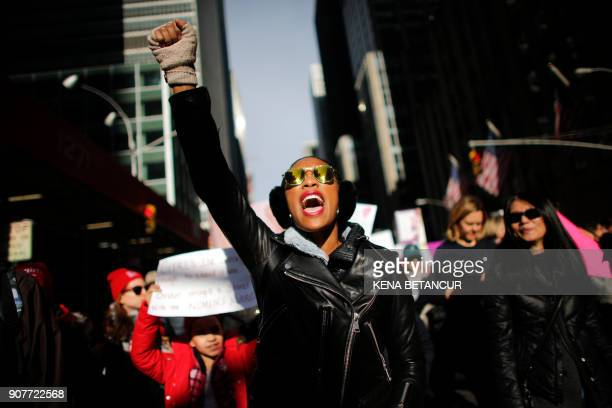 A woman shouts as she attends the Womens March on New York City on January 20 2018 in New York City / AFP PHOTO / KENA BETANCUR