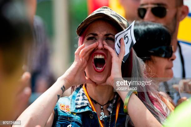 A woman shouts during a demonstration called by farright groups under the slogan 'For the closure of TV3' in front of the Catalan public televison...