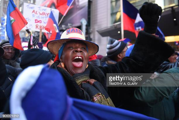 A woman shouts during a protest during a march on Martin Luther King Jr Day in Times Square called Rally Against Racism Stand Up for Haiti and Africa...