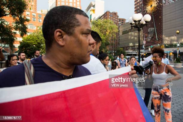 Woman shouts for a parlarte to ask for help from Cuban protesters in Union Square Park on July 14, 2021 in New York City. A small group of people...