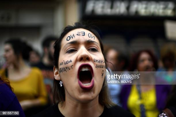 TOPSHOT A woman shouts slogans during a demonstration in Madrid on April 26 to protest after five men accused of gang raping a woman at Pamplona's...