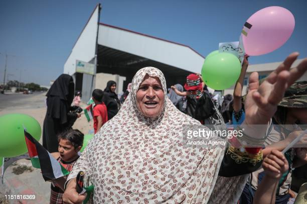 Woman shouts slogans during a protest against the U.S.-led conference in Bahrain on June 25, 2019 in Beit Lahia, Gaza. U.S. Officials are expected to...