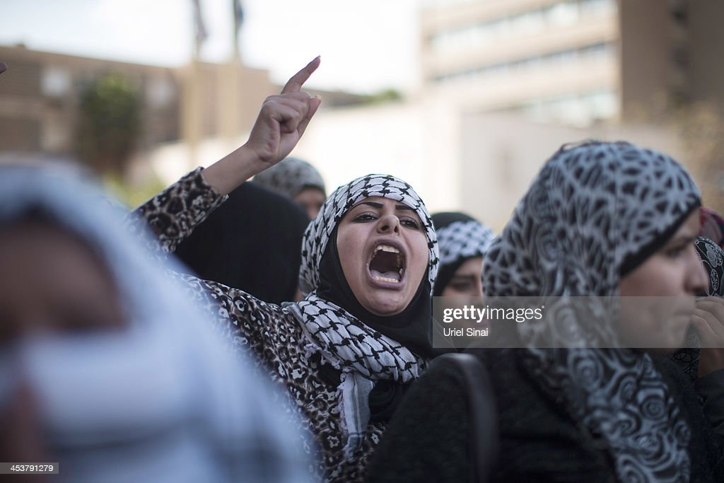A woman shouts slogans during a protest by Israeli Bedouins against the Israeli government's Prawer Plan as they gather outside an Israeli court and call for the release of fellow Bedouins arrested during last week's protest, on December 5, 2013 in Beer Sheva, Israel. Roughly 200,000 Bedouins live in the Negev desert, with about half living in the seven Israeli government built townships in the northeast of the Negev and half in unrecognized villages, which lack basic services such as clean water, electricity or sanitation. The Israeli Parliament (Knesset) is set to bring a final vote on the Prawer-Begin Bill during its winter session, If implemented the law would forcibly displace tens of thousands of Arab Bedouin citizens living in the unrecognized villages and see them settled in the seven Bedouin townships. The Negev Bedouin tribes have vowed to fight the proposed law, which they argue will dispossess them of their homes and force a final settlement to their claims of historical rights to the land.