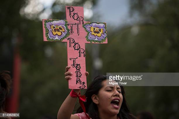 A woman shouts slogans during a protest commemorating the International Women's Day at Reforma Av on March 08 2016 in Mexico City Mexico