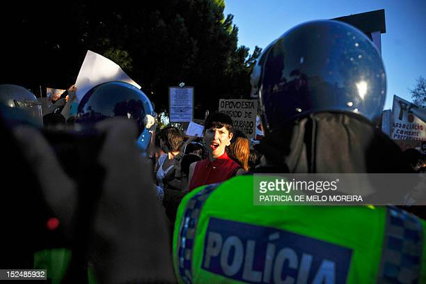 Woman shouts slogans during a protest in front of the Belem Palace in Lisbon on September 21, 2012 where is held a State Council meeting called by...