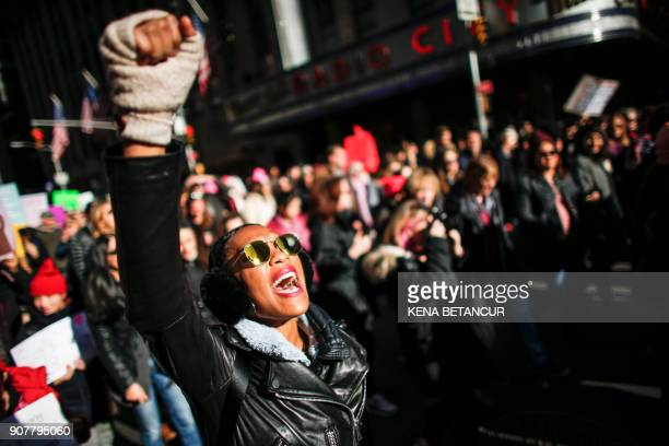 TOPSHOT A woman shouts slogans during the Women's March in New York City January 20 as protestors took to the streets en masse across the United...