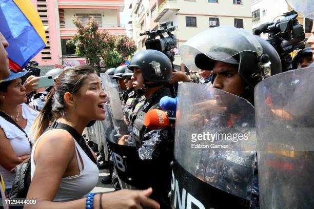 A woman shouts to a line of Bolivarian National Police officers PNB during a protest against the government of Nicolas Maduro on March 9 2019 in...