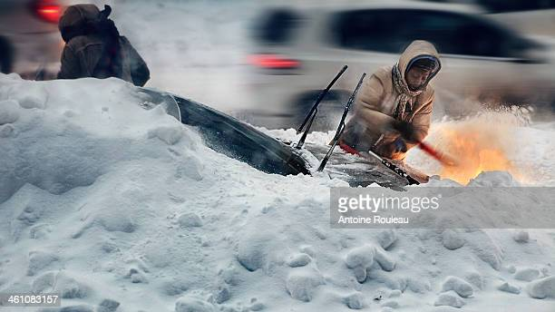 Woman shoveling her car after a snow storm, Montreal, Quebec, Canada, december 2012