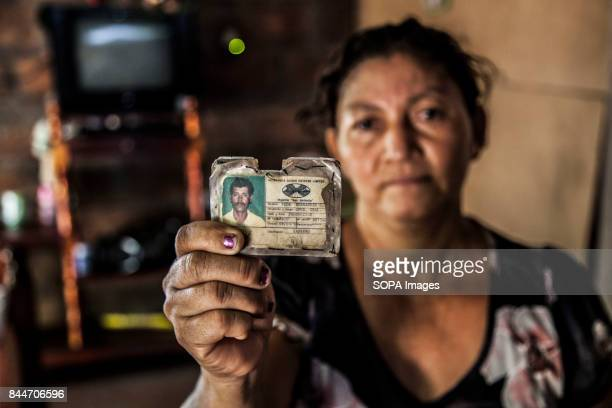 CHICHIGALPA CHINANDEGA NICARAGUA A woman show the identity card of her husband that passed away from a chronic kidney disease The Island of Widowed...