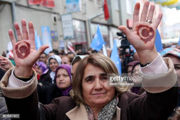 A woman show their hands to represent a Turkish flag designed with henna at rally in Yozgat by Iyi Parti