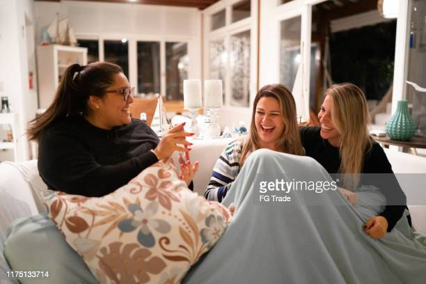 woman showing a funny thing on smartphone - night in stock pictures, royalty-free photos & images