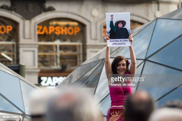 A woman showing a picture of Maxima Acuna celebrating the 7th anniversary of the 15M movement