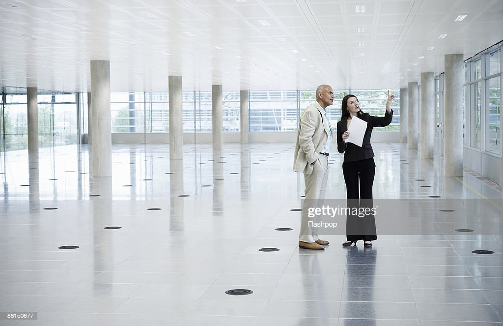 Woman showing business man office space : Stock Photo