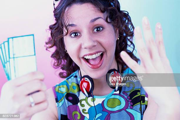 Woman Showing Concert Tickets