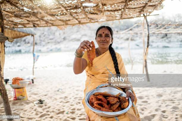 woman showing fish, india - adults only stock pictures, royalty-free photos & images