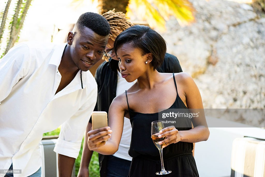 Woman Showing Her Friend Her Mobile Phone : Stock Photo