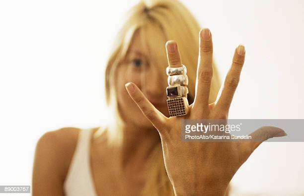 woman showing many rings on her finger to camera - female exhibitionist stock photos and pictures