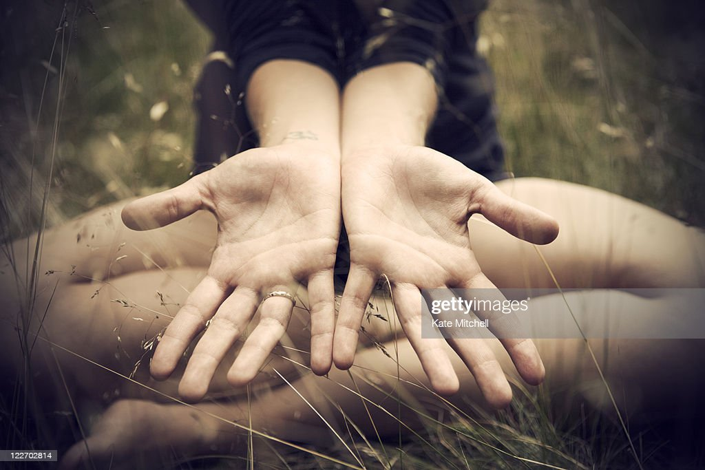Woman showing open palms : Stock Photo