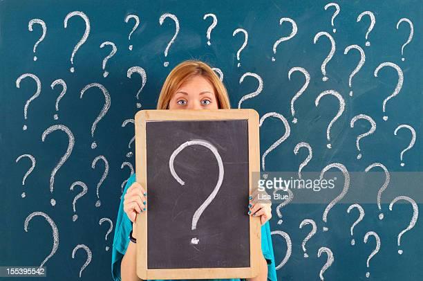 Woman Showing Question Mark on Blackboard