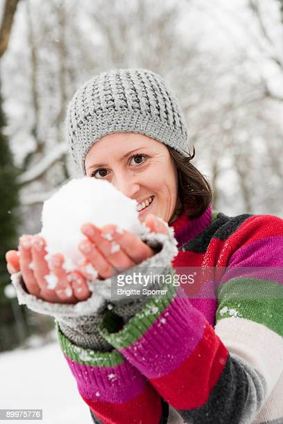 woman showing snowball