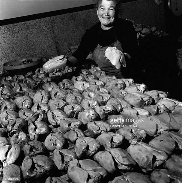 Woman showing some foies gras on December 30, 1948 in Souillac, France.